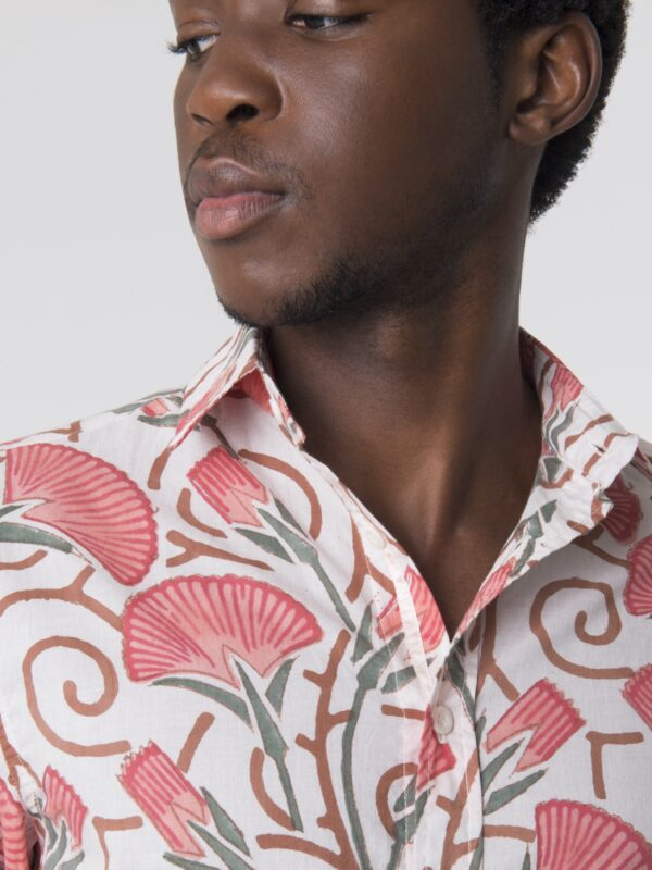 A close up shot of the collar and buttons of the Mdiga block printed shirt from Wildrose.