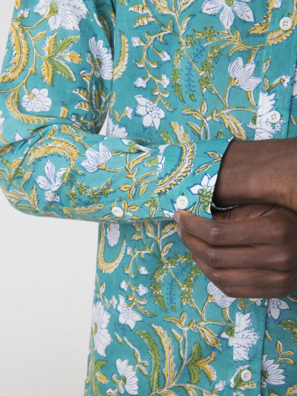 A close up shot of a floral printed shirt cuff.