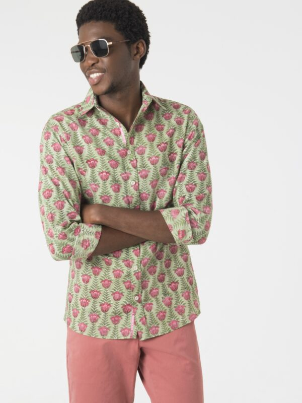 A man wearing sunglasses modelling the Sukari Kichaka shirt with folded arms.