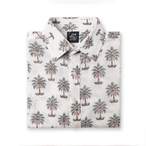 A folded block printed shirt with a repeated tree pattern.
