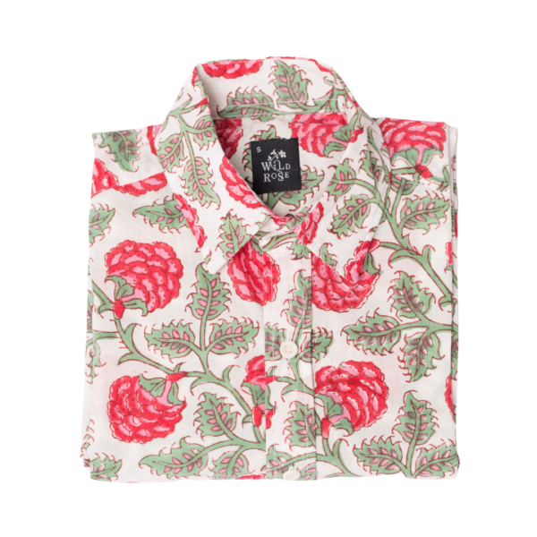 A folded shirt with floral red and green pattern print.