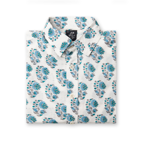 A folded white shirt with floral Blue and green pattern print.