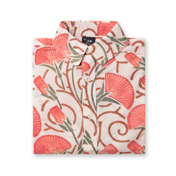 A folded white shirt with floral pink and brown pattern print.