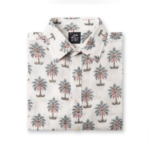 Folded shirt with a Wild Rose labels and green and red palm trees