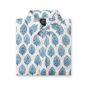 A folded white shirt with blue and green leaf pattern print.