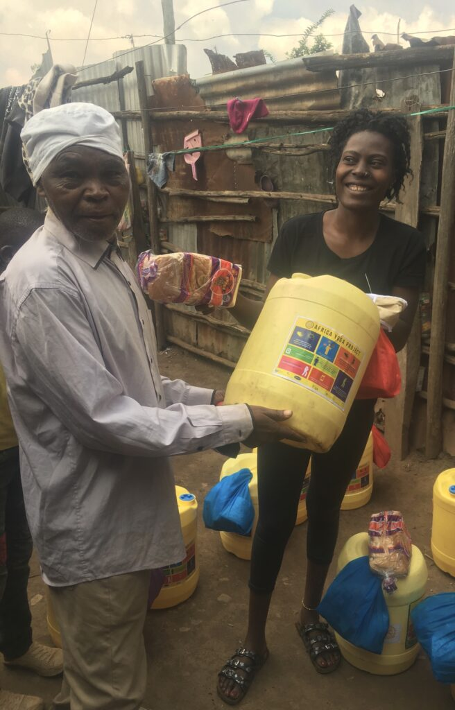African man and woman holding large drum of sanitiser fromAfrica Yoga Project to prevent Covid 19