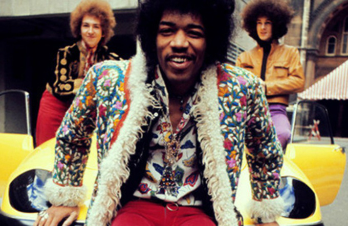 Musician Jimi Hendrix wearing printed shirt and jacket